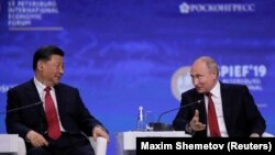 ولادیمیر پوتین، رییس جمهور روسیه و شی جین پنیگ، رییس جمهور چین