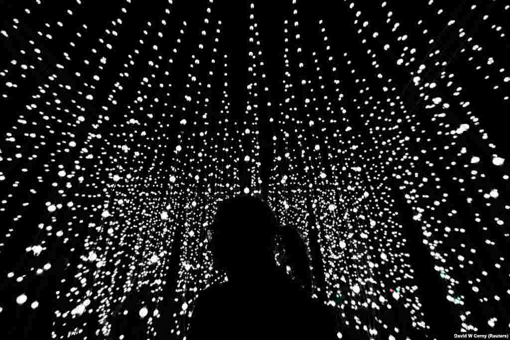 A woman stands in front of an installation during the Signal light festival in Prague. (Reuters/David W. Cerny)