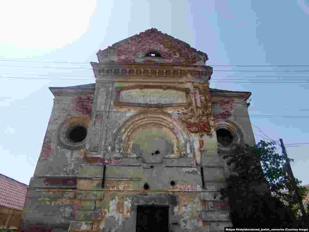 A gutted synagogue in a Slovak town where some 500 Jews once lived. Today only pigeons frequent the ancient structure.