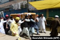 Afghan Sikhs carry the coffin of one of the 19 victims of a suicide attack in Jalalabad.