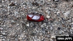 IA child's shoe is pictured at the scene of a Ukrainian airliner that crashed shortly after take-off near Tehran.