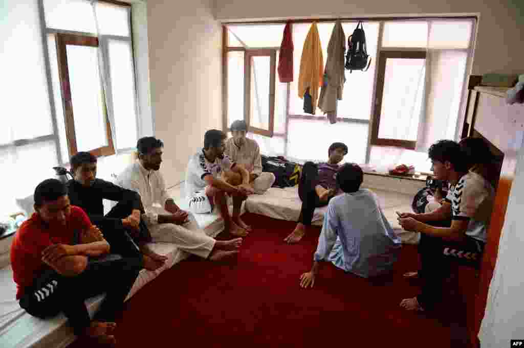 Afghan players relax in their dormitory.