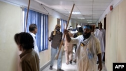 Pakistani opposition protesters shout anti-anti government slogans after storming the headquarters of the state owned Pakistan Television building during anti-government protests in Islamabad, September 1, 2014.
