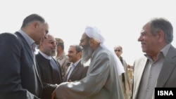 Iranian president Hassan Rohani visiting Sisatan and Baluchistan Province in south east of Iran. Sunni religious leader Molavi Abdol-Hamid, greeting the president at airport, 15 April 2014.