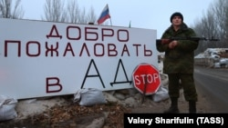Ukraine - An armed member of the Donetsk People's Republic (DPR) militia at a checkpoint at the entrance to Horlivka, December 14, 2014