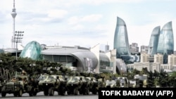Azerbaijan -- A column of military vehicles rolls during a rehearsal of a military parade in Baku, 21Jun2013