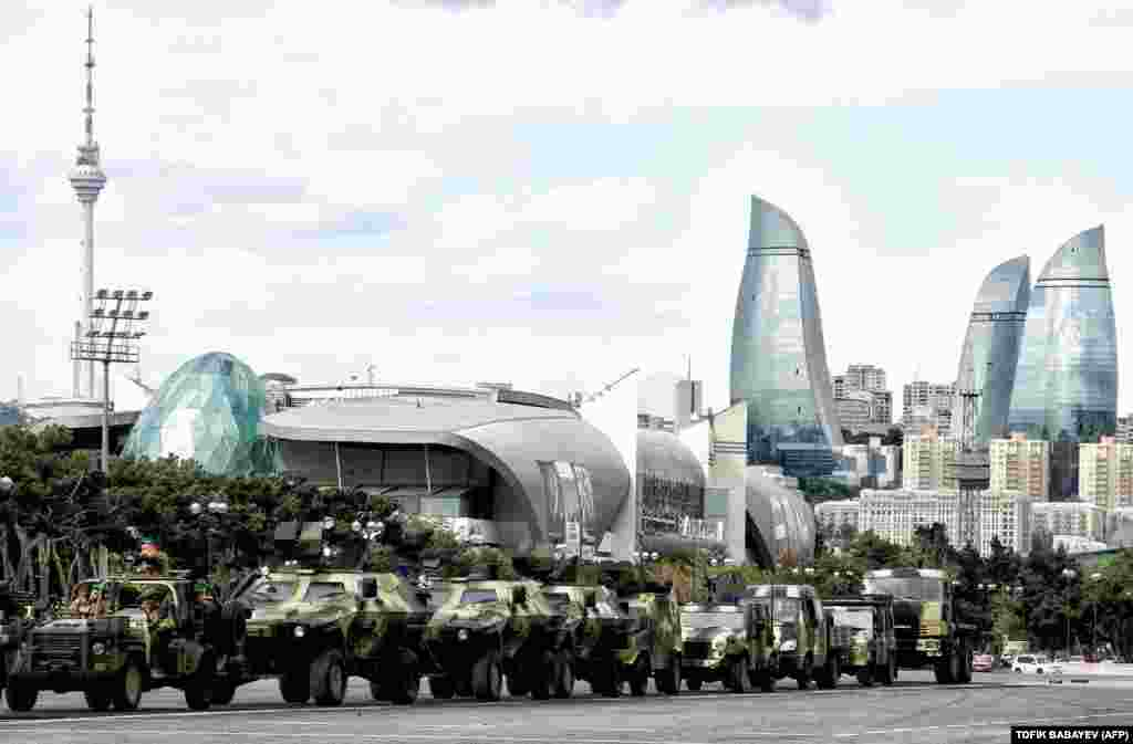 A column of military vehicles participates in a rehearsal of a military parade in Baku, Azerbaijan. (AFP/Tofik Babayev)