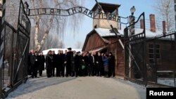 Members of an Israeli parliamentary delegation pose at the entrance to the former Auschwitz concentration camp during a ceremony to mark International Holocaust Remembrance Day on January 27.