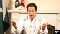 Pakistan's cricketer-turned politician Imran Khan, head of the Pakistan Tehreek-e-Insaf (Movement for Justice) party, addresses the nation at his residence in Islamabad a day after the elections on July 26.