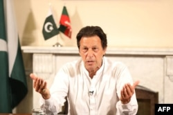 Imran Khan addresses the nation at his residence in Islamabad the day after general elections. His foreign policy views have raised eyebrows.