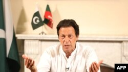 PAKISTAN - Pakistan's cricketer-turned politician Imran Khan, and head of the Pakistan Tehreek-e-Insaf (Movement for Justice) party, addresses the nation at his residence in Islamabad a day after general election, Islamabad, July 26, 2018