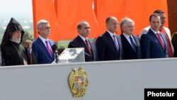 Armenia - Businessman Gagik Tsarukian (R) stands alongside President Serzh Sarkisian and other officials during the celebration of Republic Day at the Sardarapat war memorial, 28May2013.