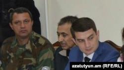 Азербайджанец Дильхам Аскеров (в центре) в суде, Степанакерт, 27 октября 2014 г.