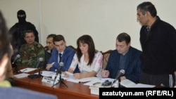 Nagorno Karabakh - Shahbaz Quliyev (R) and Dilgam Askerov (third from L), Azerbaijani men charged by Karabakh's authorities with sabotage, stand trial in Stepanakert,27Oct,2014