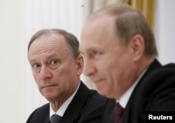 Russian Security Council Secretary Nikolai Patrushev (left) and President Vladimir Putin