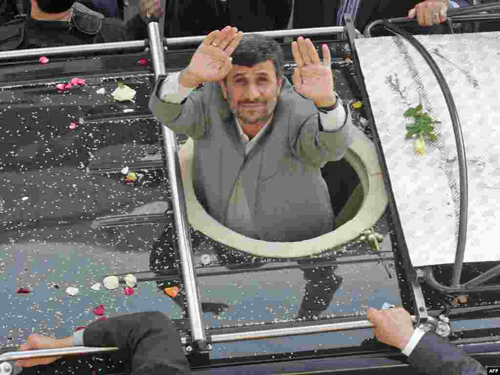 Iran's President Mahmud Ahmadinejad salutes the crowd as he crosses Beirut airport highway on his first visit to the east Mediterranean country on October 13. The hard-line leader arrived in Beirut on October 13 for a controversial two-day visit, the highlight of which was a tour of Lebanon's volatile border with his arch-enemy Israel. Photo by AFP