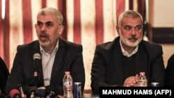 PALESTINE -- Yahya Sinwar (L), leader of the Islamist Hamas movement in the Gaza Strip, and the movement's political bureau head Ismail Haniyeh meet with the heads of families in Gaza City on December 26, 2017, to discuss recent developments on the reconc