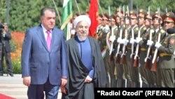 Tajik President Emomali Rahmon (left) welcomes Iranian President Hassan Rohani in Dushanbe.