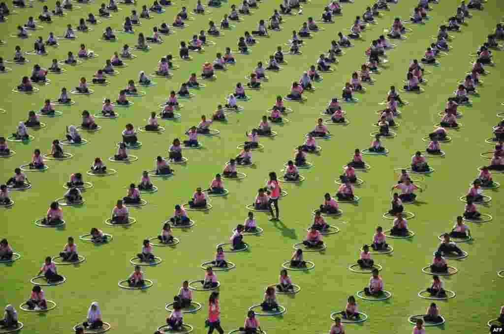 People take part in a mass Hula Hoop event in a stadium at Thammasat University Rangsit campus in Bangkok, Thailand. The event was organised by Thailand's Public Health Ministry to promote exercise. (AFP/Thai Public Health Ministry)