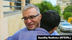 Azerbaijani opposition leader Ilqar Mammadov is greeted by a friend upon his release from prison on August 13.