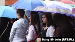 "Bosnia-Herzegovina -- A light rain fell as thousands of Sarajevans gathered on the city's central Titova Street for the ""Red Line Sarajevo"" commemoration marking the 11,541 people killed in the city siege that began on April 6, 1992, 06Apr2012"