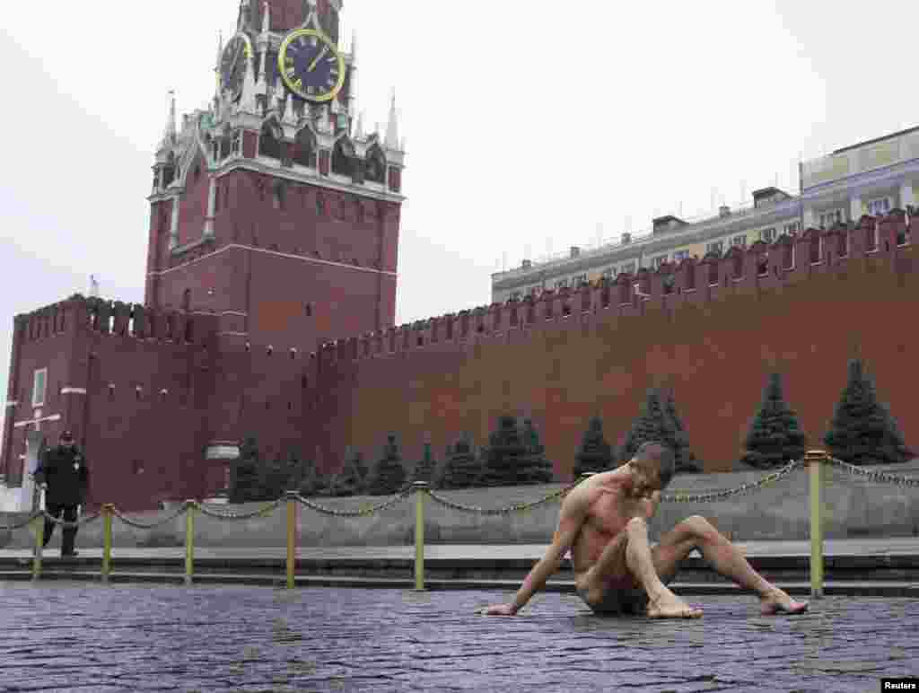 "Pavlensky nails his scrotum to cobblestones on Moscow's Red Square to protest the ""political indifference"" of Russians in November 2013."