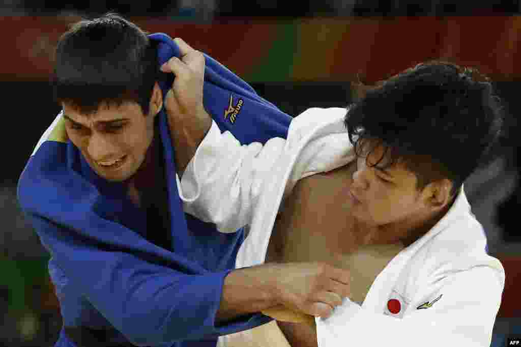 Japan's Shohei Ono (in white) won gold in the men's 73-kilogram judo division by beating Azerbaijan's Rustam Orujov.