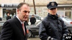 Former Kosovo Liberation Army commander Fatmir Limaj (left) at the District Court in Pristina (file photo)