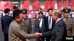Ким Чен Ир и Владимир Путин