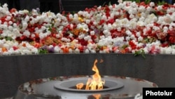 Thousands pay tribute to Armenians killed in the Ottoman massacres at the Armenian Genocide Memorial in Yerevan on April 24.