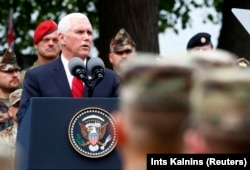 U.S. Vice President Mike Pence speaking to NATO's Enhanced Forward Presence and Estonian troops in Tallinn.