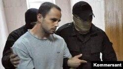 """Вячеслав Исаев при задержании, фото """"Коммерсантъ"""""""