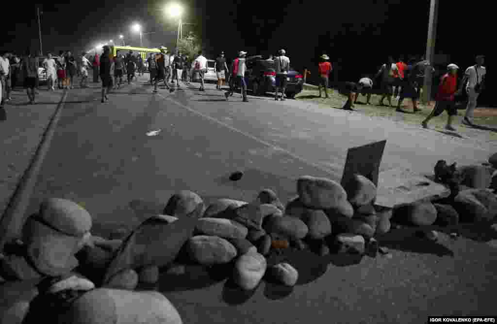 Rocks on a road leading to the compound.