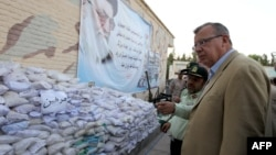 UN Office on Drugs and Crime head Yury Fedotov (right) and Iranian narcotics police chief Hamidreza Housein Abadi look at bags of Afghan-made morphine during a media tour in the city of Zahedan in July 2011.