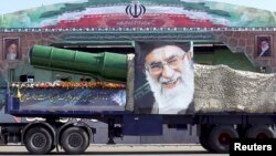 A military truck carrying a warhead and a picture of Iran's Supreme Leader Ayatollah Ali Khamenei is seen during a parade in Tehran late last year. Washington says the new sanctions have been imposed as a result of Iran's ballistic missile program.