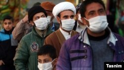 Residents of Qom, the epicenter of coronavirus outbreak in Iran, waiting to be examined by a mobile medical team. February 27, 2020.