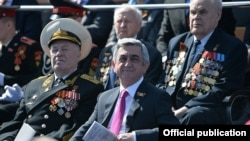 Russia - Armenian President Serzh Sarkisian watches a WW2 military parade in Moscow's Red Square, 9May2015.