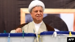 Iran's influential former president Akbar Hashemi Rafsanjani casting his ballot in presidential elections on June 12