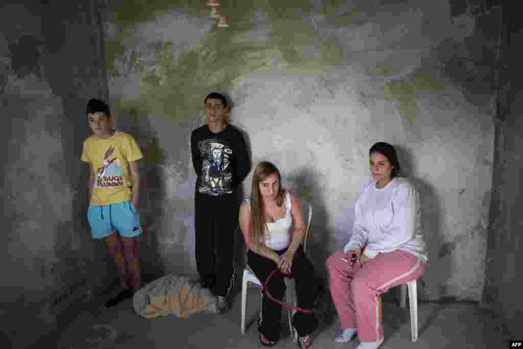 Israelis hide in a bomb shelter in the southern town of Ofakim during a Palestinian rocket attack. (AFP/Menahem Kahana)