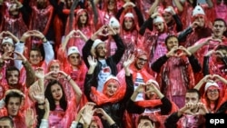 Albanian and Serbian students cheer together before the UEFA EURO 2016 qualifying soccer match between Albania and Serbia at Elbasan Arena in Elbasan on October 8.