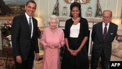 U.S. President Barack Obama (left) and his wife Michelle (second right) meet with Queen Elizabeth II (second left) and Prince Philip, the Duke of Edinburgh at Buckingham Palace in London