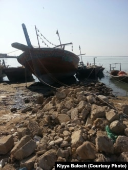 High tide can smash the wooden boats into the shore.