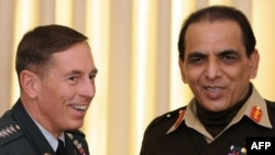 Pakistani Army chief Ashfaq Kayani (right) and U.S. General David Petraeus during a meeting in Islamabad on January 20.