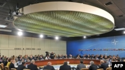 Some 56 foreign and defense ministers attended the meeting in Brussels.