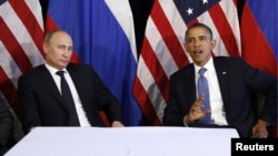 Russian President Vladimir Putin (left) and U.S. President Barack Obama during a June 2012 meeting in Los Cabos, Mexico