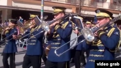 A band performs in Pristina during anniversary celebrations.
