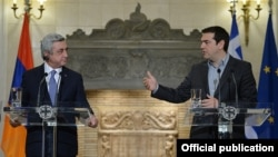Greece - Prime Minister Alexis Tsipras (R) speaks at a joint news conference with Armenian President Serzh Sarkisian, Athens, 16Mar2016.