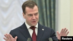Russian President Dmitry Medvedev gestures during a speech at an awards ceremony devoted to achievements in the space programme in Moscow, 12Apr2011