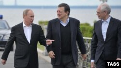 Russian President Vladimir Putin (left) walks with the president of the European Commission, Jose Manuel Barroso (center), and the president of the European Council, Herman Van Rompuy, during their meeting outside St. Petersburg on June 3.