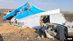 Debris from the crashed Russian jet lies strewn across the sand at the site of the crash in the Sinai.